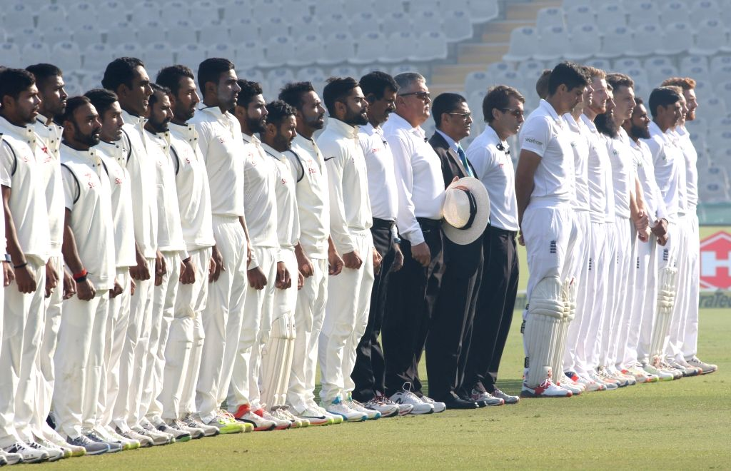 Team India and England before the start of the match on day 1 of the third test match between India and England held at the Punjab Cricket Association IS Bindra Stadium, Mohali on Nov. 26, ...