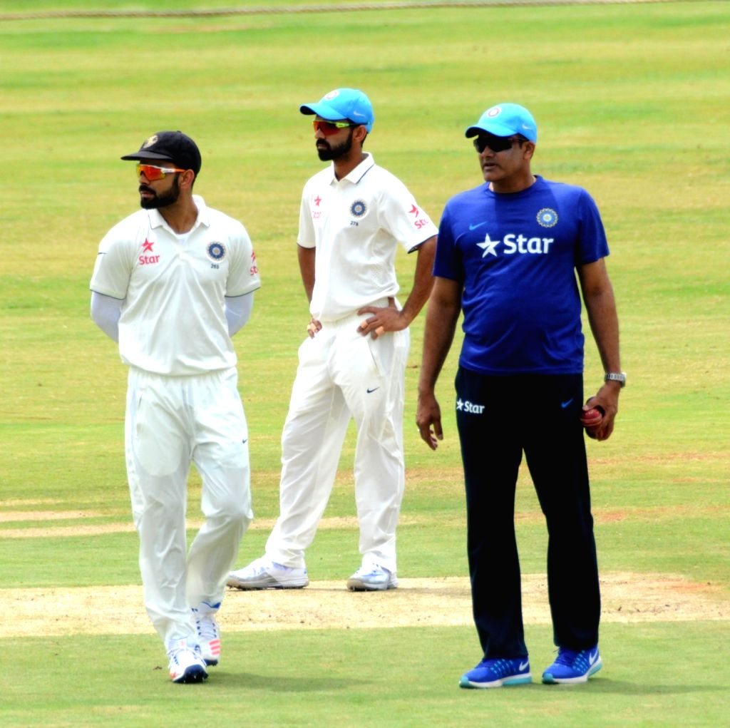 Team India coach Anil Kumble with  Virat Kohli and Ajinkye Rahane during a practice match on the fifth day of the preparatory camp held ahead of West Indies tour, in Bengaluru on July 3, ... - Virat Kohli