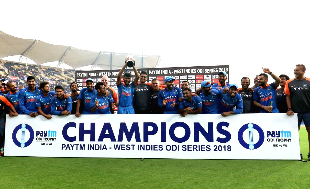 Team India pose with the trophy after winning the India - West Indies ODI Series 2018 at Greenfield International Stadium in Thiruvananthapuram, on Nov. 1, 2018. India clinch ...