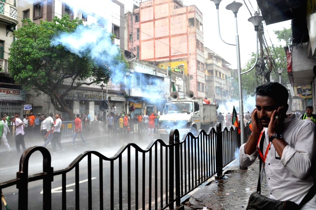 Tear gas shells lobbed by the The Rapid Action Force to stop BJP activists staging a protest march against the killing of its party men in West Bengal, from Lalbazar to Kolkata Police ...