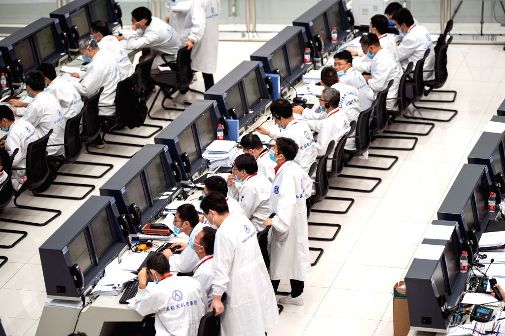Technical personnel work at the Beijing Aerospace Control Center (BACC) in Beijing, capital of China, Aug. 2, 2020. China's Mars probe Tianwen-1 successfully carried ...