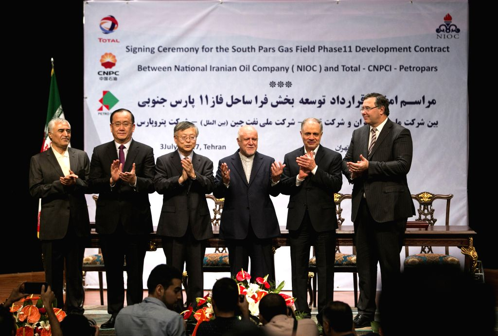 TEHERAN, July 3, 2017 - Representatives from cooperation parties attend the deal signing ceremony in Teheran, Iran, on July 3, 2017. Iran and a consortium of China National Petroleum Corporation ...