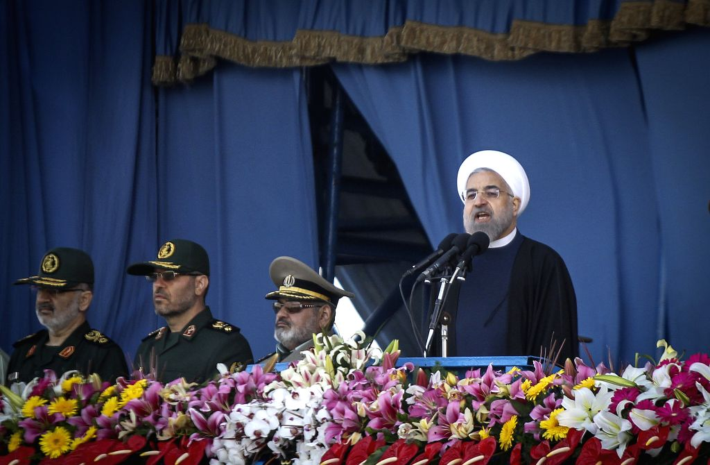 Iranian President Hassan Rouhani (R) delivers a speech during the Army Day parade in Tehran, Iran, on April 18, 2015. Different units of Iranian army staged parades ... - Hassan Rouhani