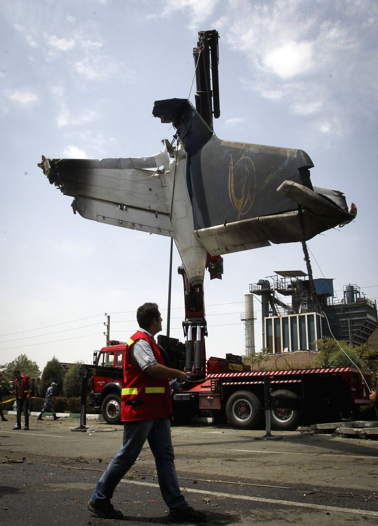 The wreckage of a plane which crashed near Tehran is collected by rescuers on Aug. 10, 2014. A passenger plane crashed on the outskirts of Iran's capital Tehran on ..