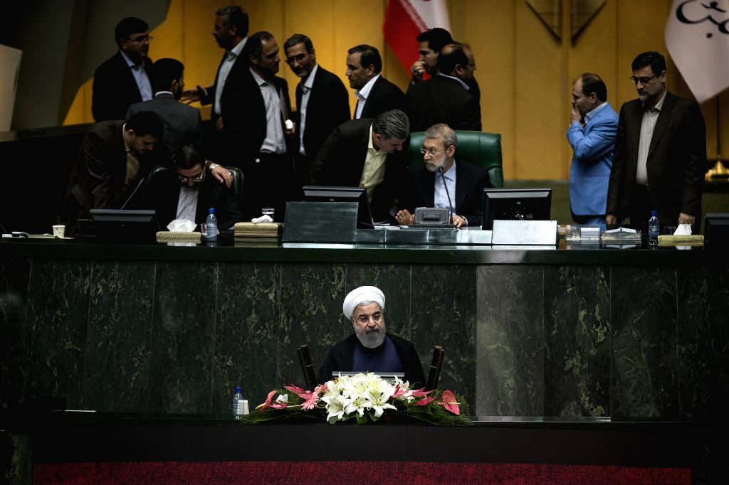 TEHRAN, Aug. 20, 2017 - Iranian President Hassan Rouhani (C) speaks at a parliament meeting in Tehran, Iran, on Aug. 20, 2017. Iran's President Hassan Rouhani said Sunday that Iran's top foreign ... - Hassan Rouhani