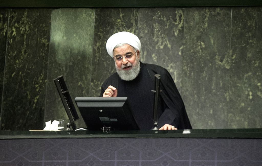 """TEHRAN, Dec. 25, 2018 (Xinhua) -- Iranian President Hassan Rouhani speaks during a session at the parliament in Tehran, Iran, on Dec. 25, 2018. Rouhani said on Tuesday that the U.S. """"oppressive"""" sanction pressures against Iran won't achieve their end - Hassan Rouhani"""