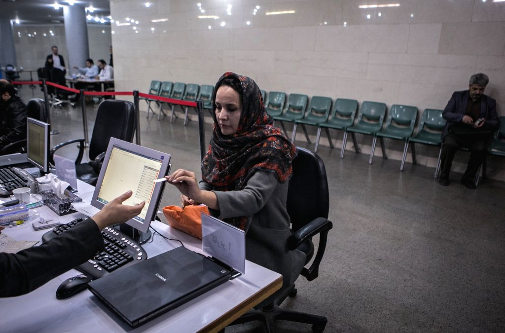 TEHRAN, Dec. 3, 2019 - An Iranian woman registers her candidacy for Iran's parliamentary election at the Interior Ministry in Tehran, Iran, on Dec. 2, 2019. Iran on Sunday began registration of the ...