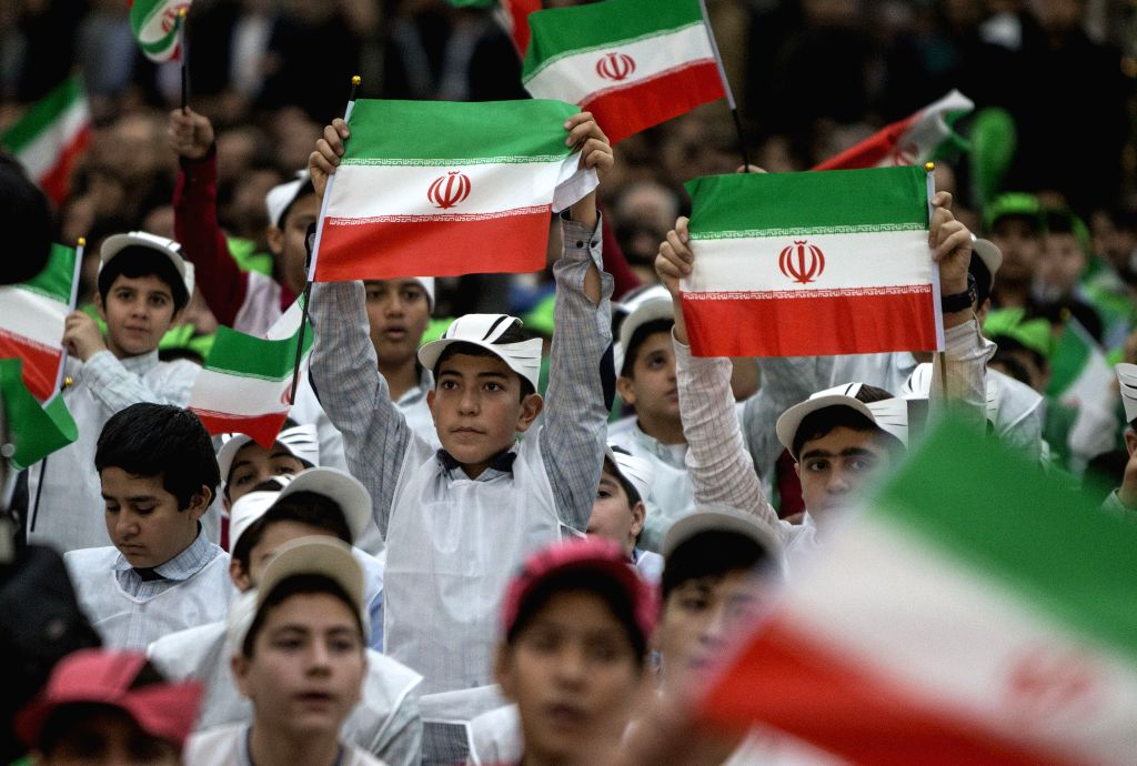 TEHRAN, Feb. 1, 2019 - Iranian children hold flags of Iran during a ceremony marking the 40th anniversary of the return of Ayatollah Ruhollah Khomeini, the Islamic Republic's founder, from exile in ...
