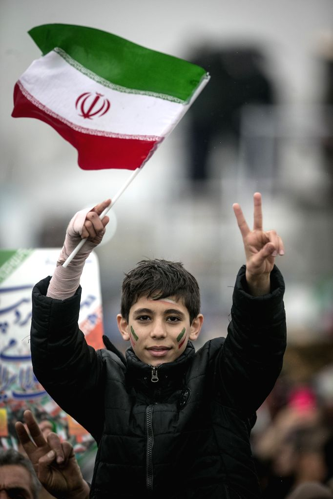 TEHRAN, Feb. 11, 2019 - A boy holds up a national flag of Iran on a large gathering on the 40th anniversary of the Islamic Revolution at Azadi Square in Tehran, Iran, on Feb. 11, 2019. On Monday, ...