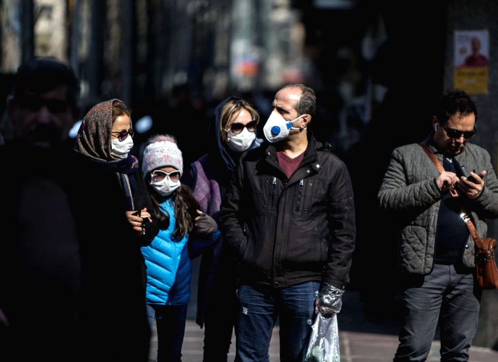 TEHRAN, Feb. 24, 2020 (Xinhua) -- People wearing masks walk in downtown Tehran, Iran, Feb. 23, 2020. Iranian President Hassan Rouhani on Sunday issued an order to form a national headquarters to cope with the outbreak of the novel coronavirus in the  - Hassan Rouhani