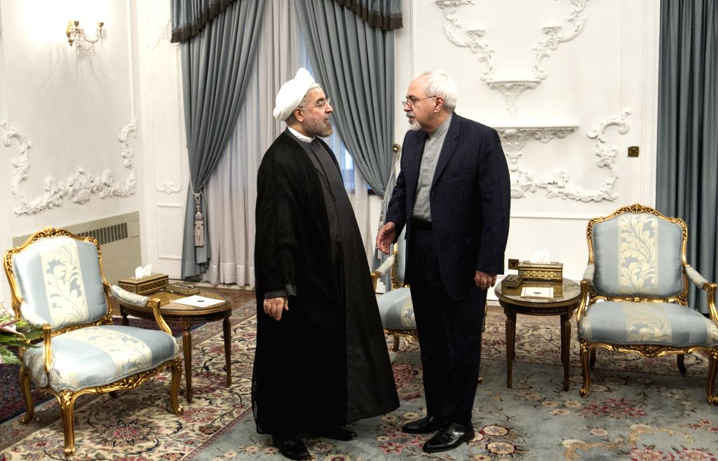 TEHRAN, Feb. 27, 2019 (Xinhua) -- Photo taken on Aug. 5, 2013 shows Iranian President Hassan Rouhani (L) talking with Foreign Minister Mohammad Javad Zarif in the presidential office in Tehran, Iran. President Hassan Rouhani on Wednesday officially r - Mohammad Javad Zarif and Hassan Rouhani