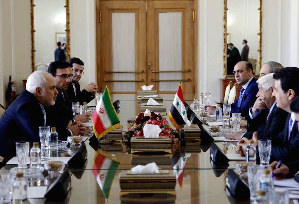 TEHRAN, Feb. 5, 2019 - Iranian Foreign Minister Mohammad Javad Zarif (1st L) meets with visiting Syrian Foreign Minister Walid Muallem (2nd R) in Tehran, capital of Iran, on Feb. 5, 2019. Iran ... - Mohammad Javad Zarif