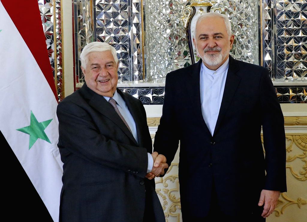 TEHRAN, Feb. 5, 2019 - Iranian Foreign Minister Mohammad Javad Zarif (R) shakes hands with visiting Syrian Foreign Minister Walid Muallem in Tehran, capital of Iran, on Feb. 5, 2019. Iran pledged on ... - Mohammad Javad Zarif