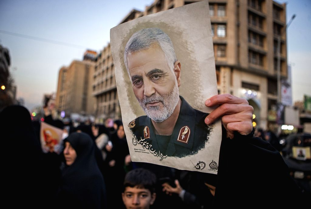 TEHRAN, Jan. 13, 2020 (Xinhua) -- A protestor holds a picture of Iranian commander Qasem Soleimani during a protest outside the British embassy in Tehran, Iran, Jan. 12, 2020. Iran's Foreign Ministry on Sunday summoned Robert Macaire, the British amb