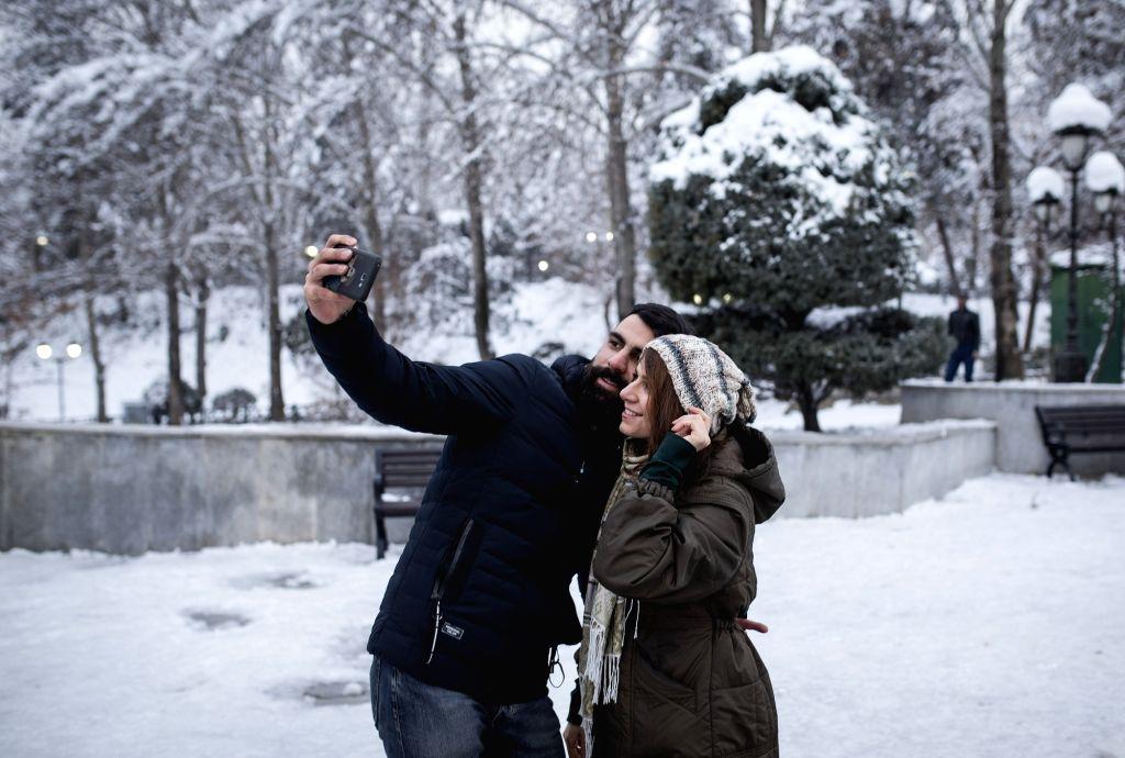 TEHRAN, Jan. 31, 2018 - People take selfie at a park after a snowfall in Tehran, capital of Iran, on Jan. 30, 2018.