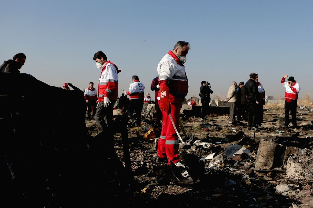 TEHRAN, Jan. 8, 2020 (Xinhua) -- Rescuers work at the air crash site of a Boeing 737 Ukrainian passenger plane in Parand district, southern Tehran, Iran, on Jan. 8, 2020. All the 179 passengers and crew members on board the Boeing 737 Ukrainian passe