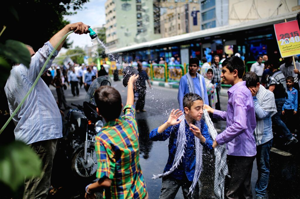 TEHRAN, July 1, 2016 - Iranian children cool off in a rally in downtown Tehran, Iran, during the Al-Quds Day on July 1, 2016. The last Friday of the Islamic holy month of Ramadan is observed in many ...