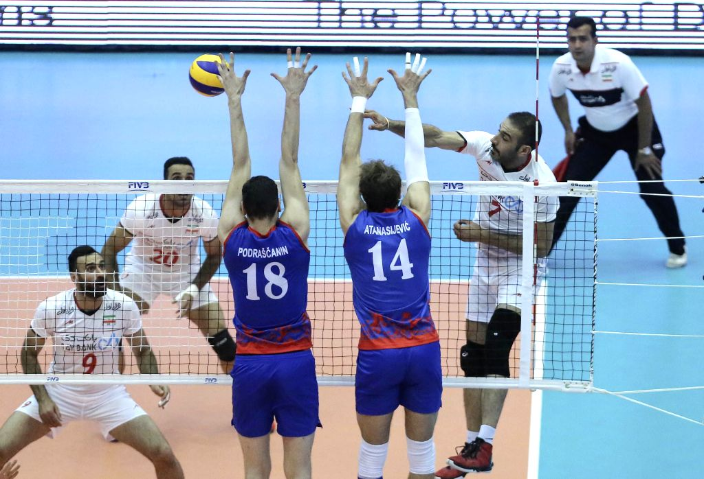 TEHRAN, July 2, 2016 - Hamzeh Zarini (2nd R) of Iran spikes the ball during the match against Serbia at FIVB Men's Volleyball World League 2016 at Azadi Stadium in Tehran, Iran, on July 1, 2016. Iran ...