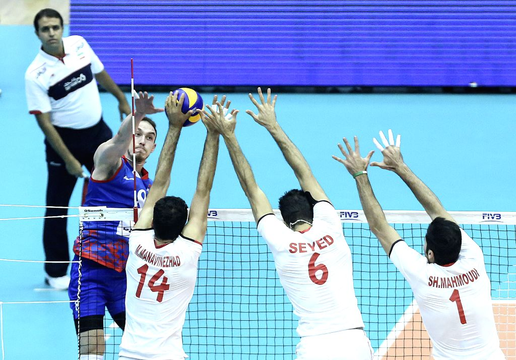 TEHRAN, July 2, 2016 - Marko Ivovic (L) of Serbia spikes the ball during the match against Iran at FIVB Men's Volleyball World League 2016 at Azadi Stadium in Tehran, Iran, on July 1, 2016. Iran won ...