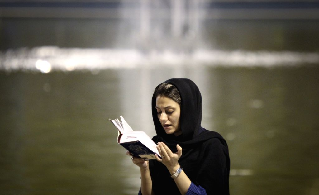 An Iranian Shiite Muslim prays during a religious ceremony of the holy month of Ramadan at the Imam Khomeini grand mosque in Tehran, Iran, on July 21, 2014. ...