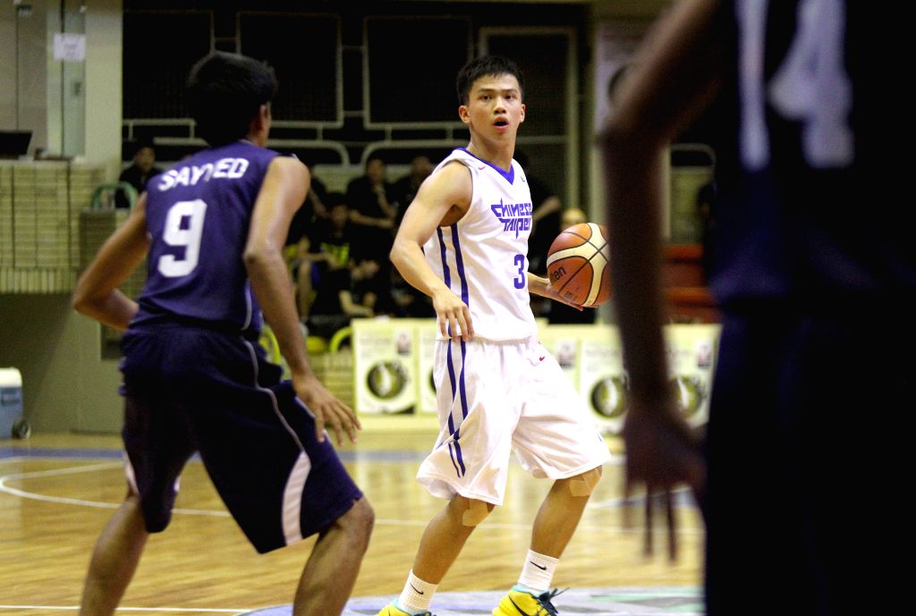 TEHRAN, July 25, 2016 - Sheng-Ju Ting (C) of Chinese Taipei drives the ball during a match between Chinese Taipei and India at the 24th FIBA Asia U18 Championship in Tehran, Iran, on July 24, 2016. ...