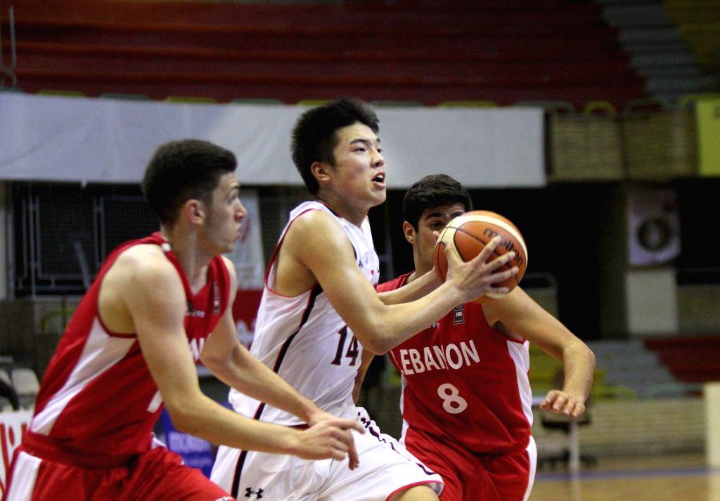 TEHRAN, July 26, 2016 - Yudai Nishida (C) of Japan competes during a match between Lebanon and Japan at 24th FIBA Asia U18 Championship in Tehran, Iran, on July 26, 2016. Japan lost the match 51-73.
