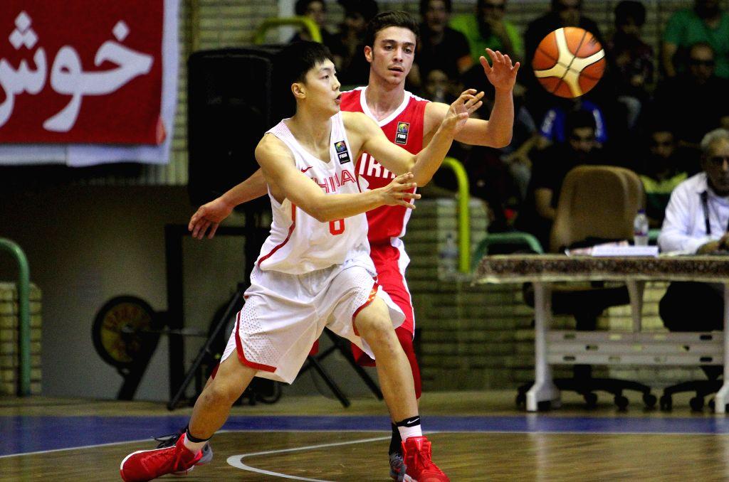 TEHRAN, July 29, 2016 - Amir Reza Shahravesh (R) of Iran vies with Mingxuan Hu of China during a match between China and Iran at 24th Fiba Asia U18 Championship in Tehran, Iran, on July 29, 2016. ...