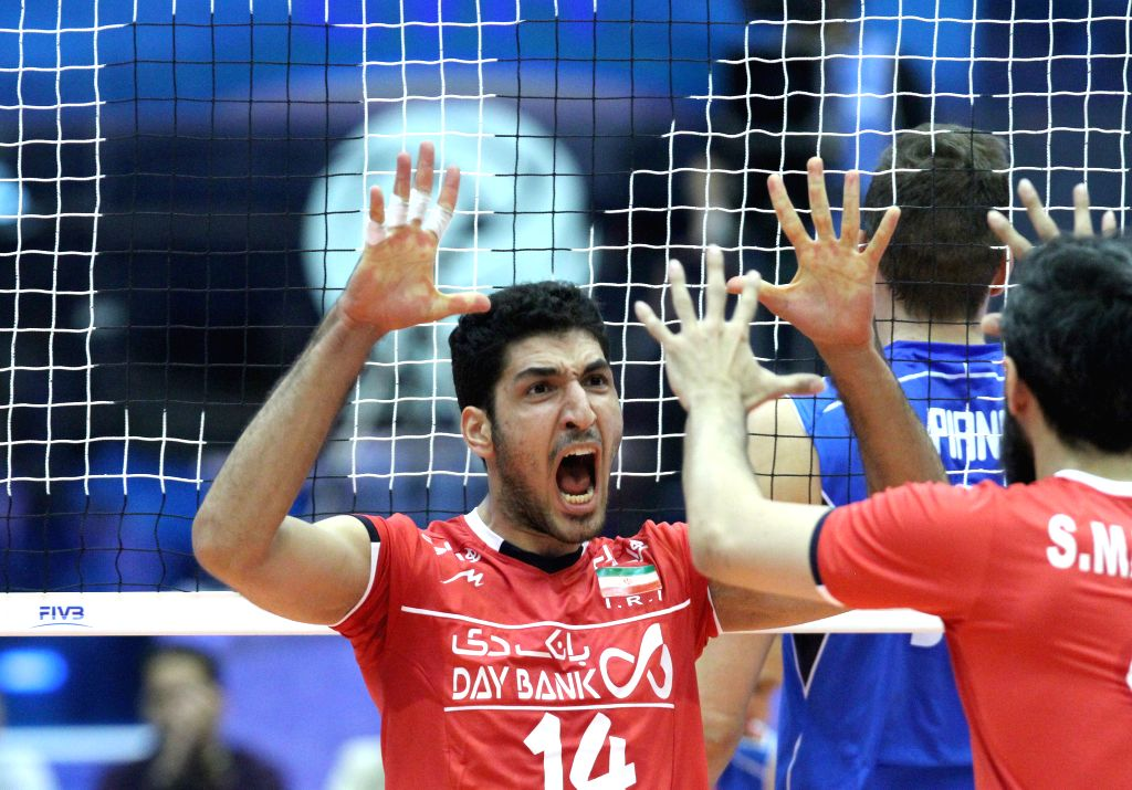 TEHRAN, July 3, 2016 - Mohammadjavad Manavibezhad (L) of Iran celebrate during a match against Italy at the FIVB Men's Volleyball World League 2016 in the Azadi Stadium in Tehran, Iran, on July 2, ...