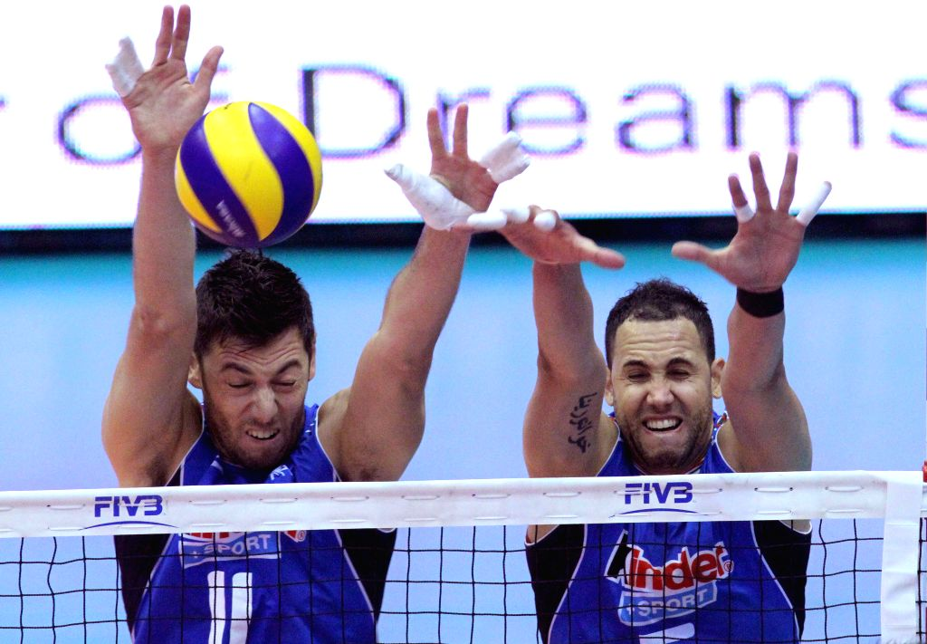 TEHRAN, July 3, 2016 - Osmany Juantorena (R) and Simone Bulti of Italy block the ball during the match against Iran at the FIVB Men's Volleyball World League 2016 in the Azadi Stadium in Tehran, ...