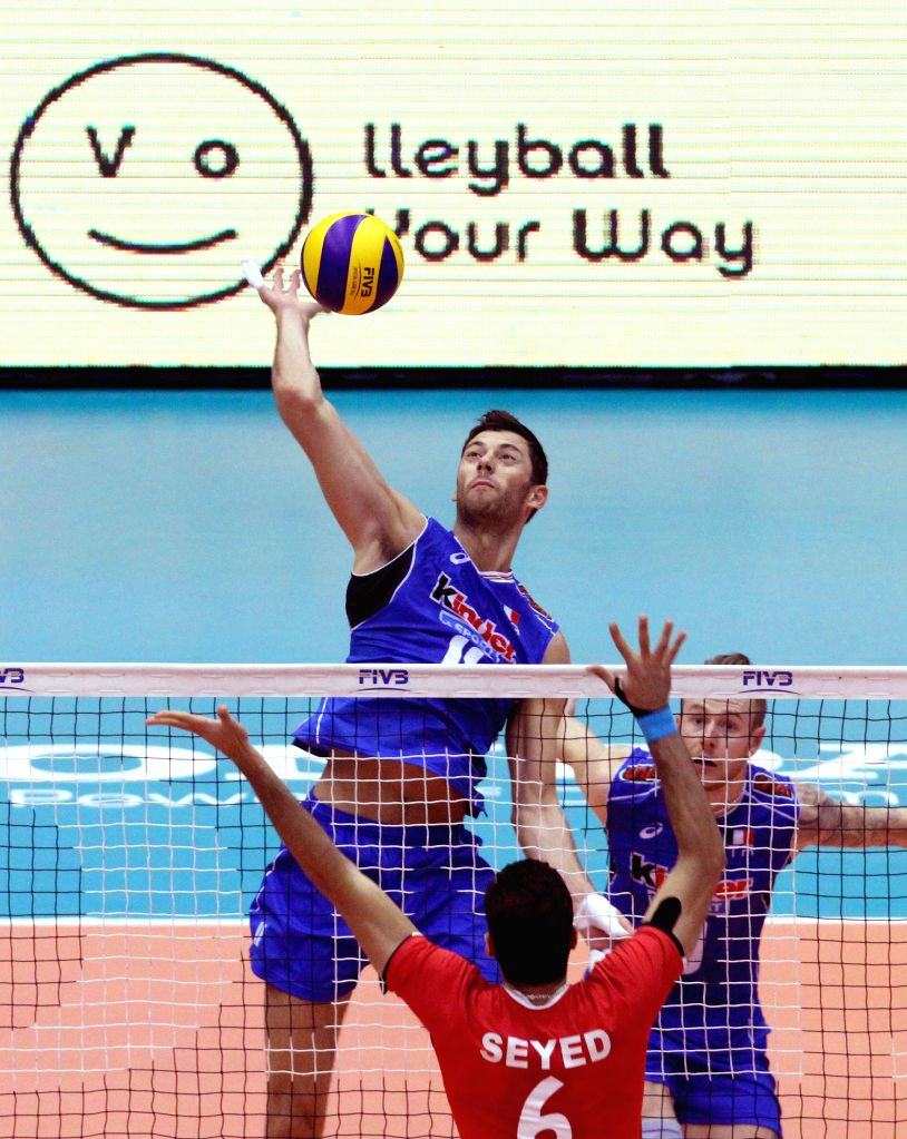 TEHRAN, July 3, 2016 - Simone Buti (top) of Italy spikes the ball during the match against Iran at the FIVB Men's Volleyball World League 2016 in the Azadi Stadium in Tehran, Iran, on July 2, 2016. ...