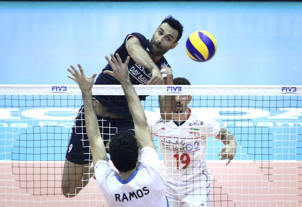 TEHRAN, July 4, 2016 - Adel Gholami (top) of Iran spikes the ball during a match against Argentina at FIVB Men's Volleyball World League 2016 at Azadi Stadium in Tehran, Iran, on July 3, 2016. Iran ...