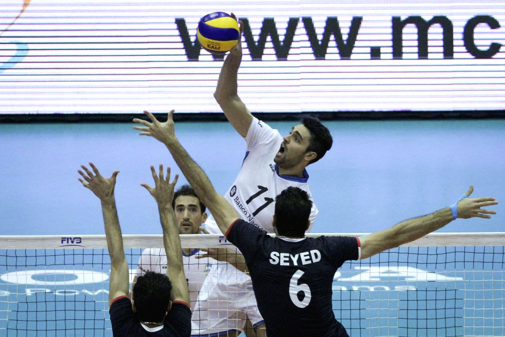 TEHRAN, July 4, 2016 - Sebastian Sole (top) of Argentina spikes the ball during a match against Iran at FIVB Men's Volleyball World League 2016 at Azadi Stadium in Tehran, Iran, on July 3, 2016. Iran ...