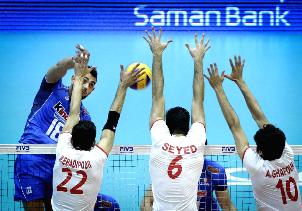 Giulio Sabbi (L) of Italy spikes the ball during their match against Iran during FIVB Men's Volleyball World League 2014 at Azadi Stadium in Tehran, Iran, on June ...