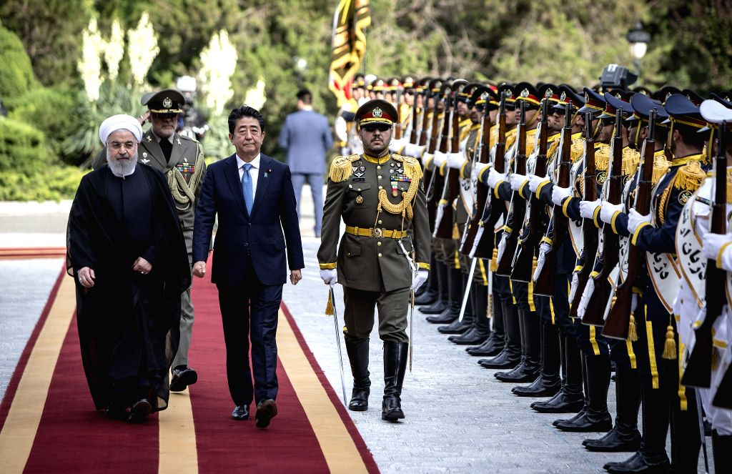 TEHRAN, June 12, 2019 - Japanese Prime Minister Shinzo Abe (2nd L, front) and Iranian President Hassan Rouhani (1st L, front) review the honor guards during a welcome ceremony in Tehran, Iran, June ... - Shinzo Abe and Hassan Rouhani