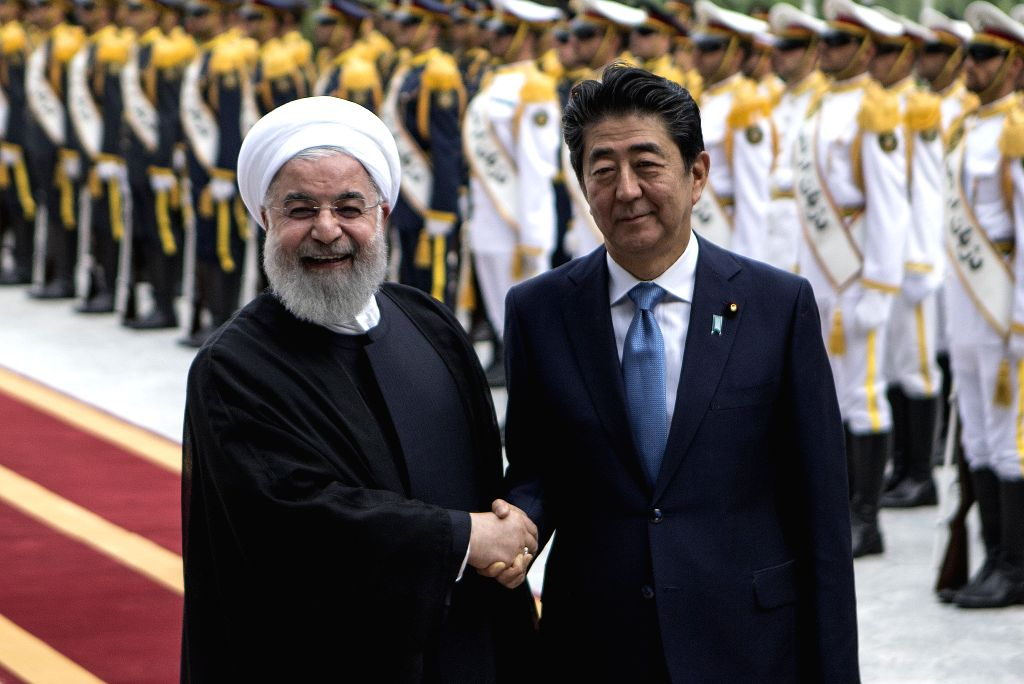 TEHRAN, June 12, 2019 (Xinhua) -- Japanese Prime Minister Shinzo Abe (R, front) shakes hands with Iranian President Hassan Rouhani during a welcome ceremony in Tehran, Iran, June 12, 2019. Iranian President Hassan Rouhani on Wednesday said that the I - Shinzo Abe and Hassan Rouhani