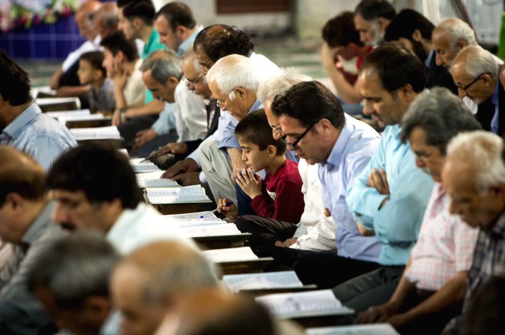 TEHRAN, June 4, 2019 - People read the Koran at a mosque during the Muslim holy month of Ramadan in Tehran, Iran, on June 3, 2019.