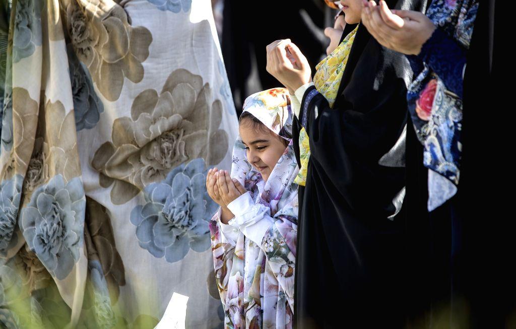 TEHRAN, June 5, 2019 - A girl attends Eid al-Fitr prayers in Tehran, capital of Iran, on June 5, 2019.