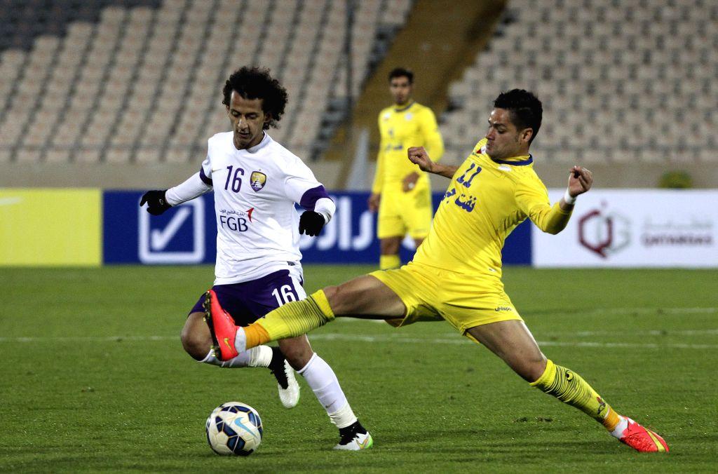 Kamaleddin Kamyabinia (R) of Iran's Naft FC vies with Mohammed Abdulrahman of UAE's Al-Ain during the Asian Champions League Group B football match at Azadi Stadium ...