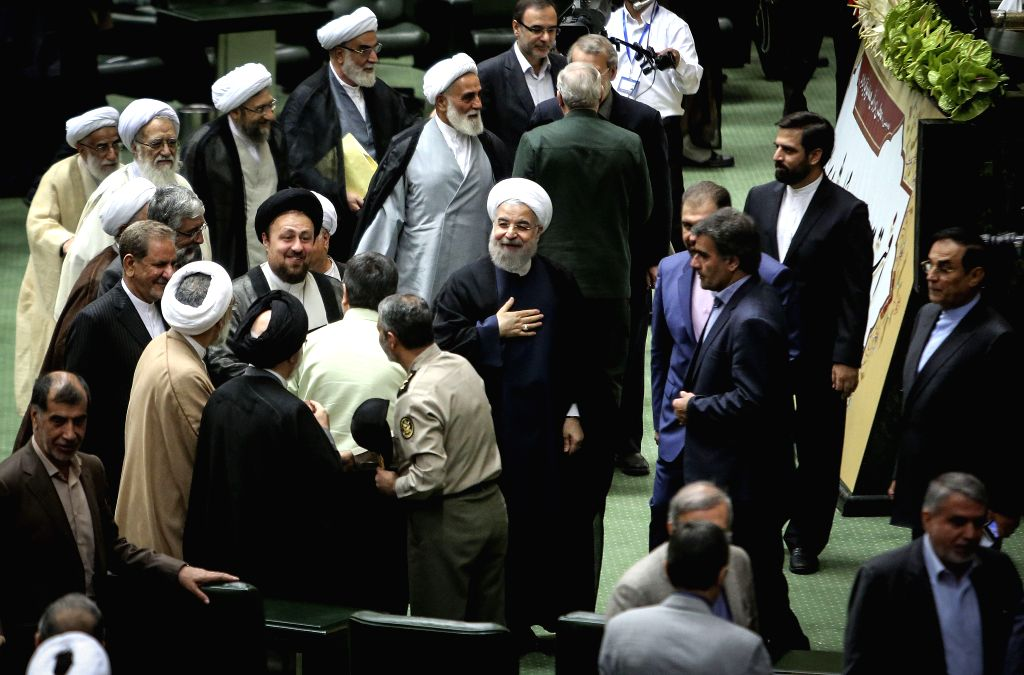 TEHRAN, May 28, 2016 - Iranian President Hassan Rouhani (C) reacts during the opening ceremony of Iran's new Majlis (parliament) in Tehran, capital of Iran, on May 28, 2016. Iran's new Majlis ... - Hassan Rouhani