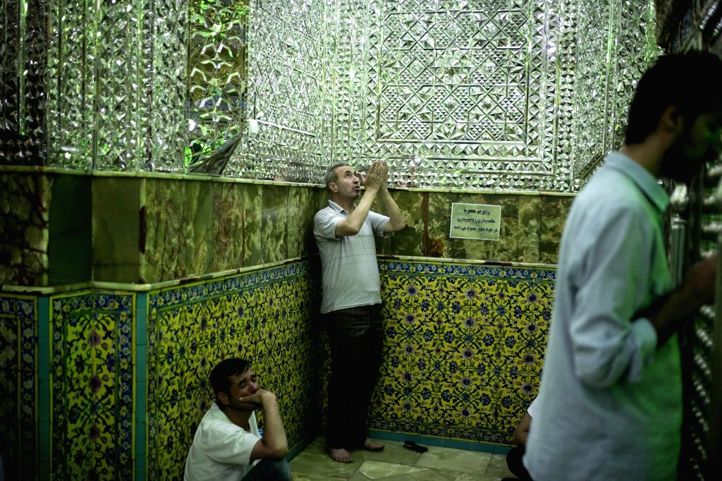 TEHRAN, May 29, 2017 - Iranian muslims pray before breaking their fast during the holy month of Ramadan at the Emamzadeh Saleh mosque in Tehran, Iran, on May 29, 2017.