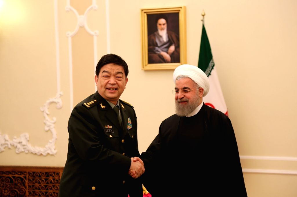 TEHRAN, Nov. 15, 2016 - Iranian President Hassan Rouhani (R) meets with Chinese Defense Minister Chang Wanquan in Tehran, Iran, Nov. 15, 2016. Chang arrived in Tehran on Sunday for a three-day visit. - Chang Wanquan and Hassan Rouhani