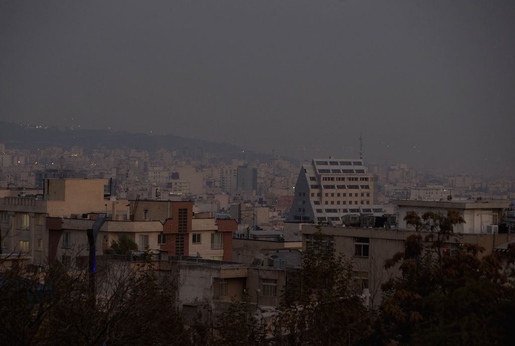 TEHRAN, Nov. 15, 2019 - Buildings are shrouded in smog in Tehran, Iran, on Nov. 14, 2019. The Iranian authorities closed kindergartens and primary schools on Wednesday over serious air pollution in ...