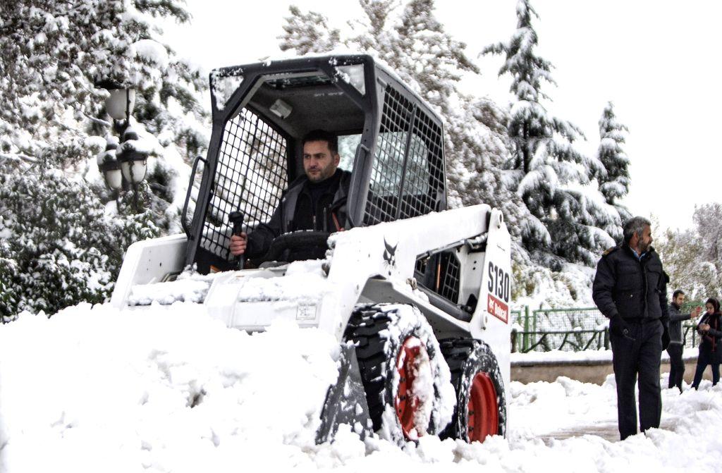 Tehran, Nov. 16, 2019 - A man drives a snowplow to clear the snow in Tehran, Iran, on Nov. 16, 2019.