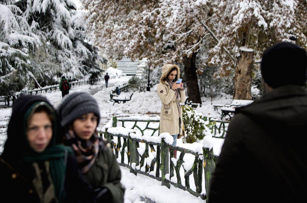 Tehran, Nov. 16, 2019 - A woman takes pictures at a park in Tehran, Iran, on Nov. 16, 2019.