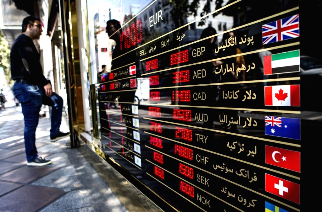 TEHRAN, Nov. 2, 2018 - People wait outside a currency exchange center in central Tehran, Iran, on Nov. 1, 2018. The U.S. sanctions to target Iran's most crucial part of the economy, namely its oil ...