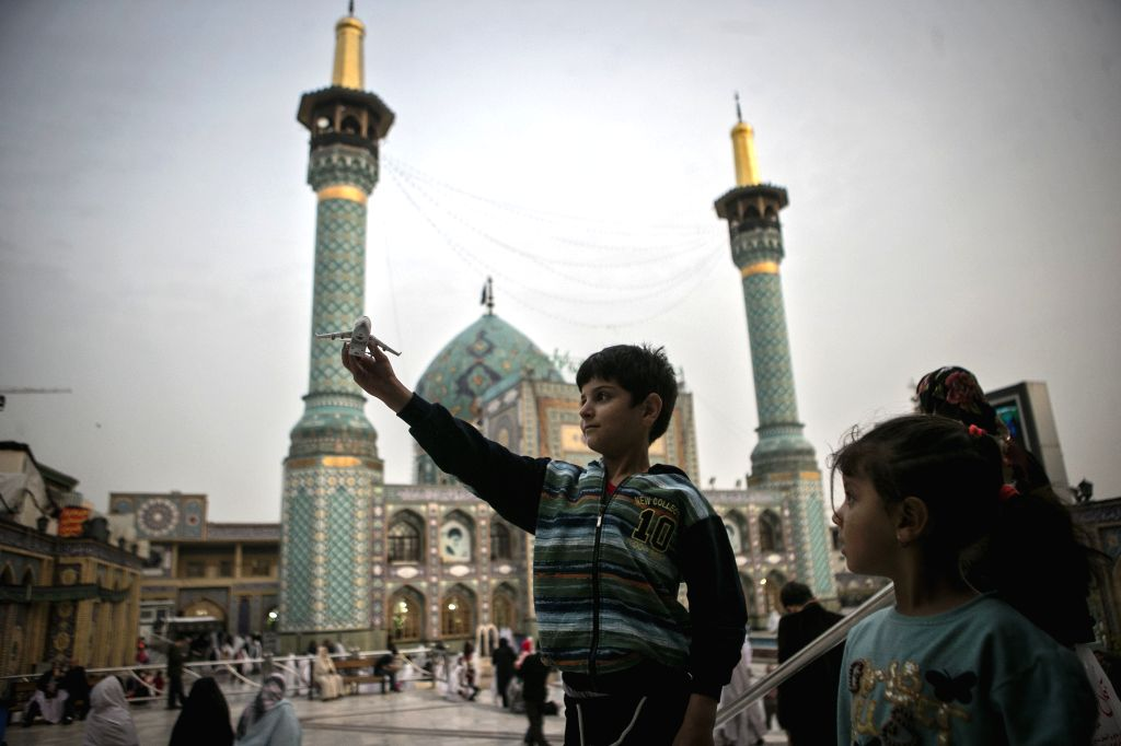 TEHRAN, Oct. 25, 2019 - Children play in front of a mosque in Tehran, Iran, on Oct. 24, 2019.