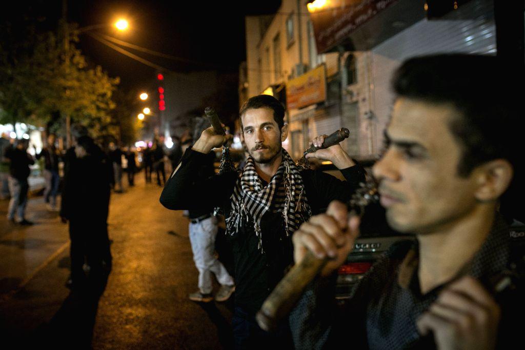 TEHRAN, Oct. 9, 2016 - Shiite Muslims mourn during a Muharram procession in Tehran, Iran, on Oct. 9, 2016.