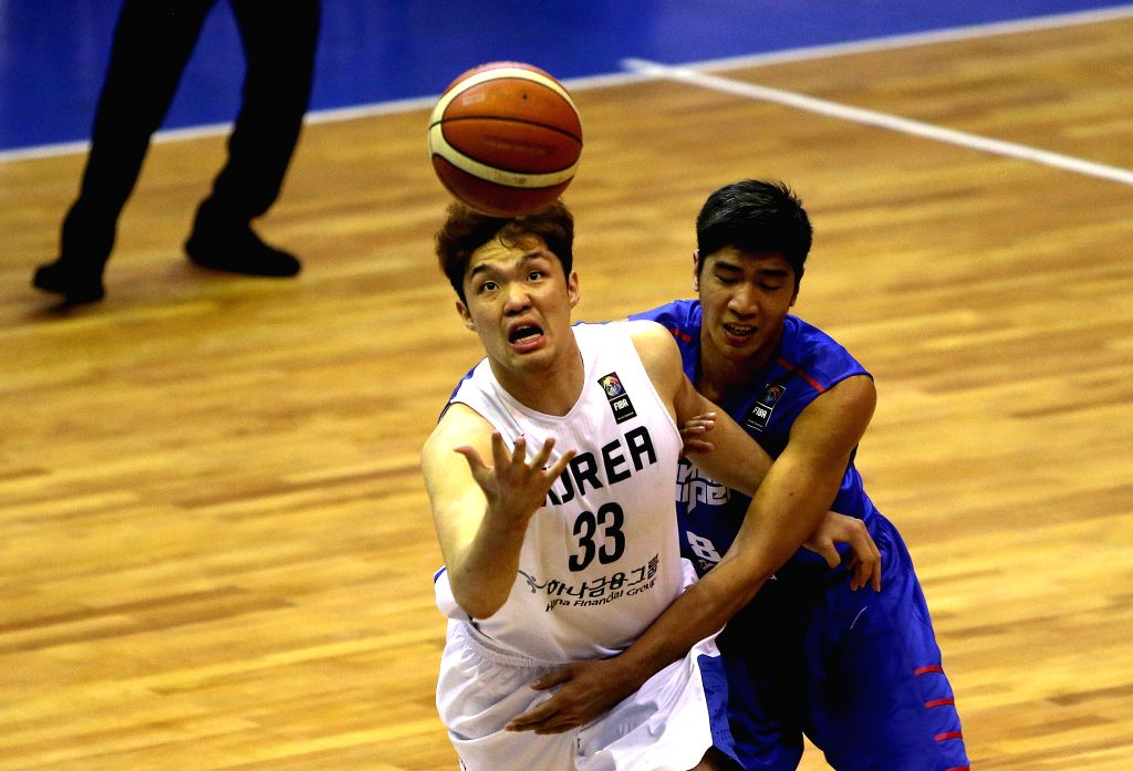TEHRAN, Sept. 16, 2016 - Lee Seounghyun (L) of South Korea vies for the ball during the match against Chinese Taipei at the 2016 FIBA Asia Challenge in Tehran, Iran, Sept. 16, 2016. South Korea won ...