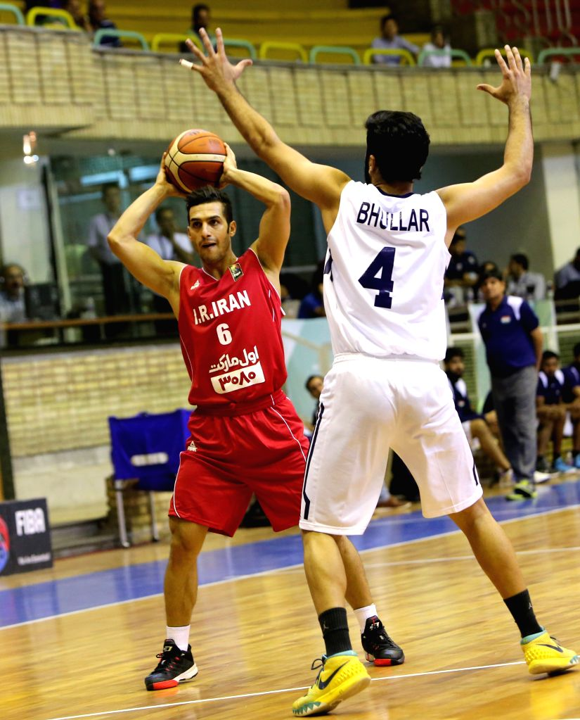 TEHRAN, Sept. 17, 2016 - Farid Aslani (L) of Iran competes during the match against India at the 2016 FIBA Asia Challenge in Tehran, Iran, Sept. 16, 2016. Iran won 85-47 and advanced to semi-final.