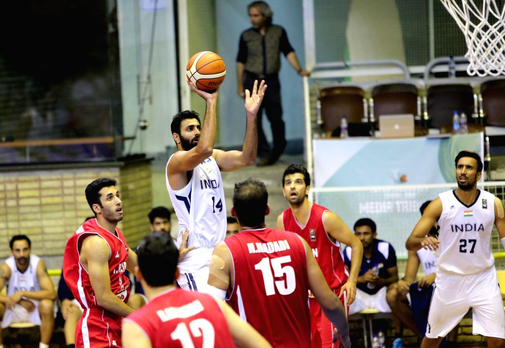TEHRAN, Sept. 17, 2016 - Yadwinder Singh (top) of India competes during the match against Iran at the 2016 FIBA Asia Challenge in Tehran, Iran, Sept. 16, 2016. Iran won 85-47 and advanced to ... - Yadwinder Singh